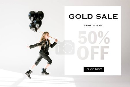 fashionable child in trendy suit jumping with black balloons on grey, gold sale banner concept