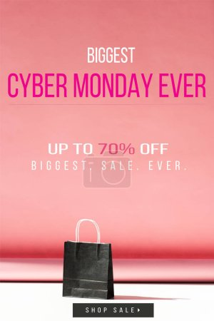 one black shopping bag on pink with copy space, cyber monday sale banner concept