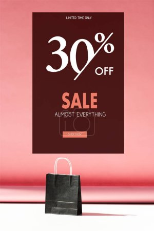 one black shopping bag on pink with copy space, sale banner concept