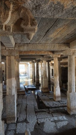 Photo for UNDERGROUND SHIVA TEMPLE, an ancient Hindu complex, located below ground level, periodically flooded with water. Many columns, murals and murals recreate different images of Shiva. Hampi, Karnataka, India - Royalty Free Image