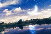 Rural forest near a river night landscape with crescent moon, photo manipulation, edited colors.