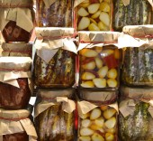 background of many glass jars with typical italian food from Calabria Region garlic anchovies very spicy