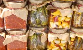 background of many glass jars with typical italian food from Calabria Region garlic anchovies very spicy and tomato sauce with peppers