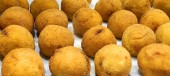 rice balls are the typical specialties of Southern Italy fried in hot oil