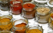 glass jars with many oriental spices such as curry pepper piucante paprika turmeric to flavor the dishes