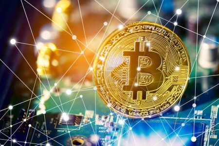 Photo for Bitcoin on electronic circuit board. Cryptography and Electronic money concept. Currency trading and Gold mining theme. Business and Technology theme. Network line dot link and light elements - Royalty Free Image