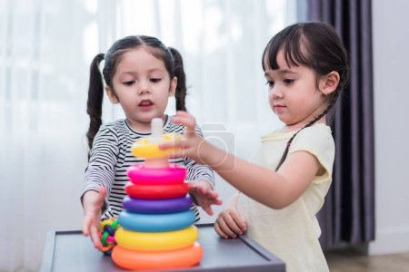 Photo for Two little girls playing small toy balls in home together. Education and Happiness lifestyle concept. Funny learning and Children development theme. Group of kids - Royalty Free Image