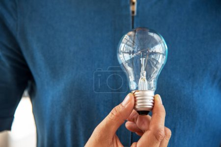 Photo for Light bulb in woman hand. Idea and Creative concept. Success and Thinking concept. Object and People theme. - Royalty Free Image