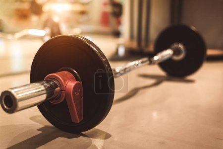 Photo for Set of black heavy steel barbells on fitness sport gym floor. Object and exercise concept. Workout training and bodybuilder. Sport equipment and instrument for weight strength props - Royalty Free Image