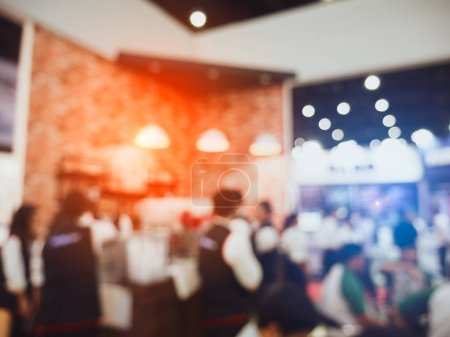 Photo for Blurry background coffee shop and crowd people and serving waiter in restaurant. Service and occupation part time job concept. Meeting in convention hall cafe theme. Blue and orange light - Royalty Free Image