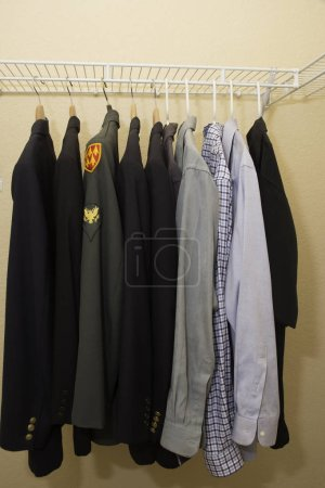 Photo for Military clothing in a closet with shirts and jackets - Royalty Free Image