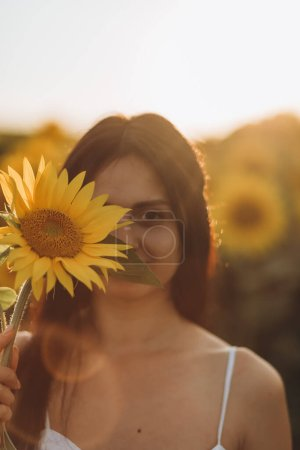 Photo for Portrait of a beautiful dark-haired woman with sunflowers - Royalty Free Image