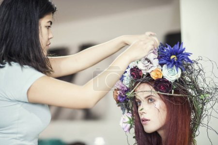 Backstage with hair stylist and model