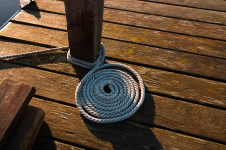 Rope or knot on wooden pier