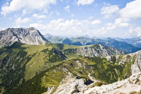 Panoramic view of beautiful mountain landscape in the Alps with green mountain