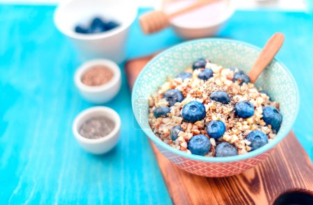 Photo for High protein healthy breakfast, buckwheat porridge with blueberries, flax seeds - Royalty Free Image