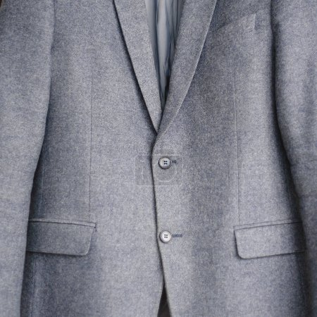 Close-up of a button on a blue business jacket