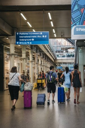 Photo for London, UK - July 26, 2018: People walking inside St. Pancras Station, rear view. St. Pancras is one of the largest railway stations in London and a home to Eurostar. - Royalty Free Image