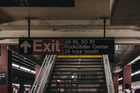 Photo for New York, USA - May 31,  2018: Subway exit sign to 49s, 50s street and Rockefeller Center from subway platform in New York. New York City Subway is one of the world's oldest public transit systems. - Royalty Free Image