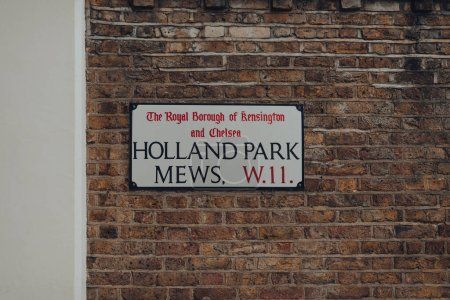 Photo for London, UK - June 20, 2020: Holland Park Mews street name sign on a wall in The Royal Borough of Kensington and Chelsea, an affluent area in West London loved by celebrities. - Royalty Free Image