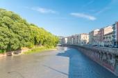 View of alpine river Dora Riparia at sunny day in Turin, Italy.