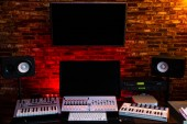 home studio. midi keyboard synthesizer, computer and digital recording equipment in sound studio for post production, editing, sound design, film score in music production and movie industrial