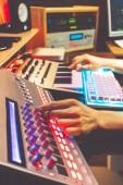 DJ, producer, composer, sound engineer, editor hands working in sound studio, broadcasting studio, home studio for post production