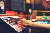 DJ, producer, composer, sound engineer, editor working in sound studio, broadcasting studio, home studio for post production