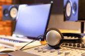 headphone on mixing console in recording studio