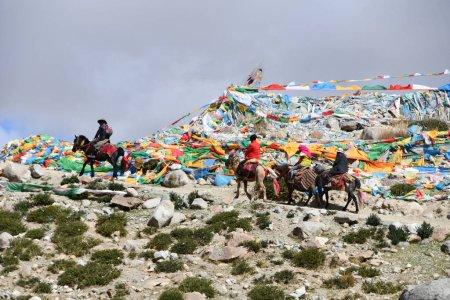 Dorchen, Tibet, China, June, 18, 2018. Mann with a horse  making parikrama around Kailas in Tibet