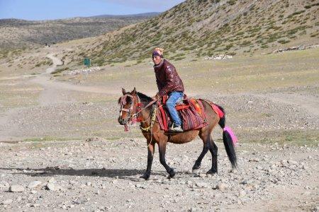 Dorchen, Tibet, China, June, 18, 2018. People  riding a horse  making parikrama around Kailas in Tibet