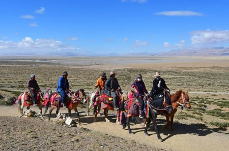 Dorchen, Tibet, China, June, 18, 2018. People with a horse  making parikrama around Kailas in Tibet
