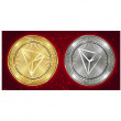 Golden and silver Tron (TRX) cryptocurrency coins ...