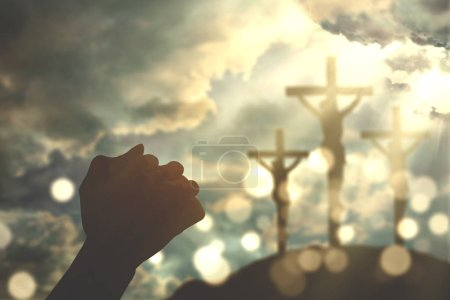 Photo for Silhouette of two christian person hands worshipping to the GOD with three crucifixion signs - Royalty Free Image