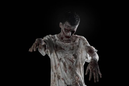 Photo for Halloween horror concept: Picture of horrible zombie man with bloody clothes - Royalty Free Image