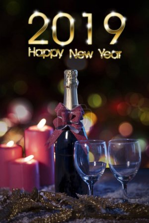 Photo for Text of 2019 Happy New Year with champagne bottle and red candles over snow - Royalty Free Image