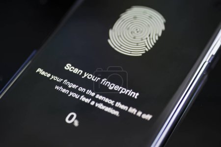 Smartphone displaying fingerprint id scans