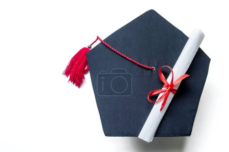 Photo for Top view of graduation hats and diploma, isolated on white background - Royalty Free Image