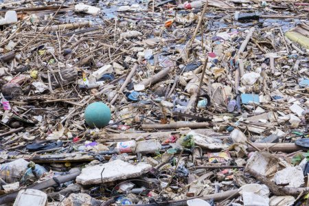 Photo for JAKARTA - Indonesia. September 18, 2019: Heaped garbage floating on the polluted river in Jakarta city - Royalty Free Image