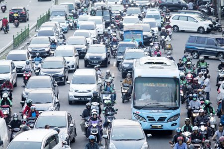 Photo for JAKARTA - Indonesia. September 25, 2019: Aerial view of cars and motorcycles on hectic highway in Jakarta city - Royalty Free Image