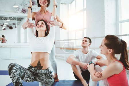 Photo for Group of adult healthy woman practice yoga poses together indoor class early morning. Healthy lifestyle concept. Woman health care - Royalty Free Image