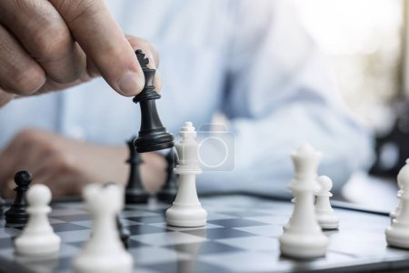 Photo for Businessman's hand playing chess game to development analysis new strategy plan, business strategy leader and teamwork concept for win and success. - Royalty Free Image