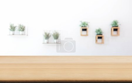 Photo for Empty wooden table and blurred background of abstract in front of coffee shop or restaurant for display of product or for montage. - Royalty Free Image