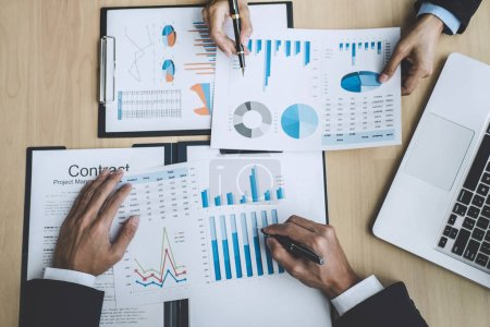 Photo for Finance manager meeting discussing company growth project success financial statistics, professional investor working start up project for strategy plan with document, laptop and digital tablet. - Royalty Free Image