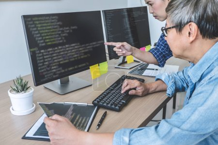 Photo for Two professional programmers cooperating at Developing programming and website working in a software develop company office, writing codes and typing data code. - Royalty Free Image