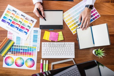 Image of male creative graphic designer working on color selecti
