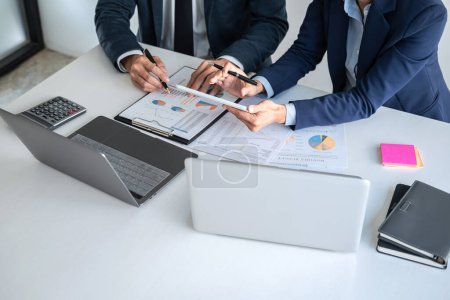 Photo for Business team are working with leader, Presentation to colleagues and business strategy and having a discussion, pointing to the graph and chart, success of cooperation partnership. - Royalty Free Image