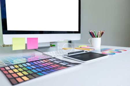 Photo for Modern office workplace with tablet, Graphic designer and color swatch samples at workplace. - Royalty Free Image
