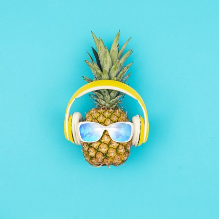 Photo for Funny fresh pineapple wearing sunglasses and headphones, summer fun concept - Royalty Free Image