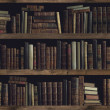 Collection of valuable ancient books on a wooden b...